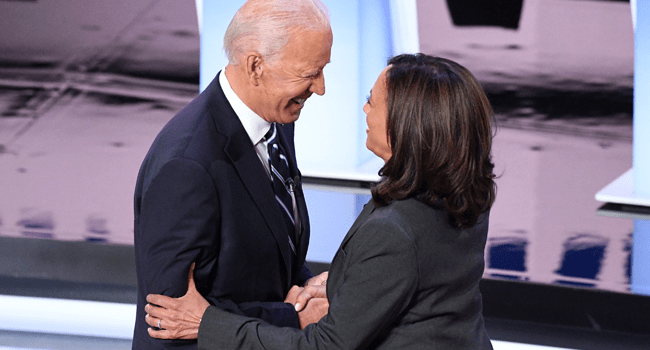 In this file photo taken on July 31, 2019, Democratic presidential hopefuls former Vice President Joe Biden (L) and US Senator from California Kamala Harris greet each other ahead of the second round of the second Democratic primary debate of the 2020 presidential campaign season at the Fox Theatre in Detroit, Michigan. Jim WATSON / AFP