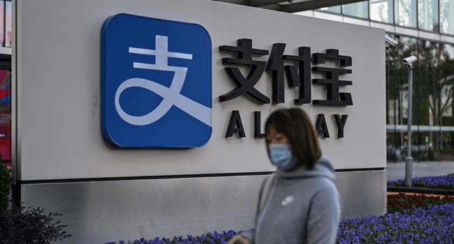 The logo of China's pioneering digital payments firm Alipay is pictured outside the office block of its parent company Ant Group in Shanghai on November 4, 2020. Hector RETAMAL / AFP