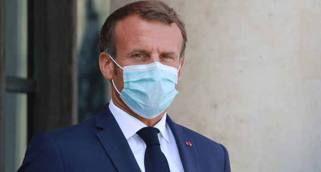 In this file photo taken on August 26, 2020 French President Emmanuel Macron, wearing a face mask, looks on as he waits for Senegal's President to arrive for their meeting at the Elysee Palace in Paris. Ludovic Marin / AFP