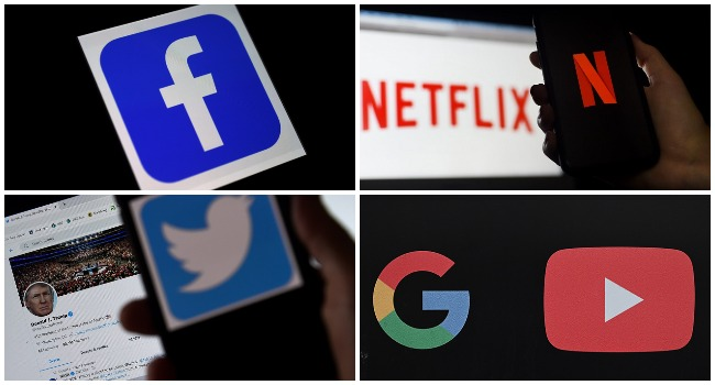 A photo combination created on December 10, 2020 showing visual identities of internet giants Facebook, Netflix, Twitter and Google.