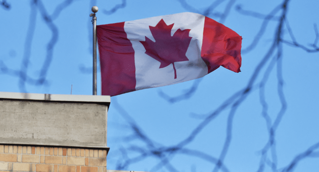 In this file photo the Canadian flag flies above the Canadian embassy in Beijing on January 15, 2019. GREG BAKER / AFP