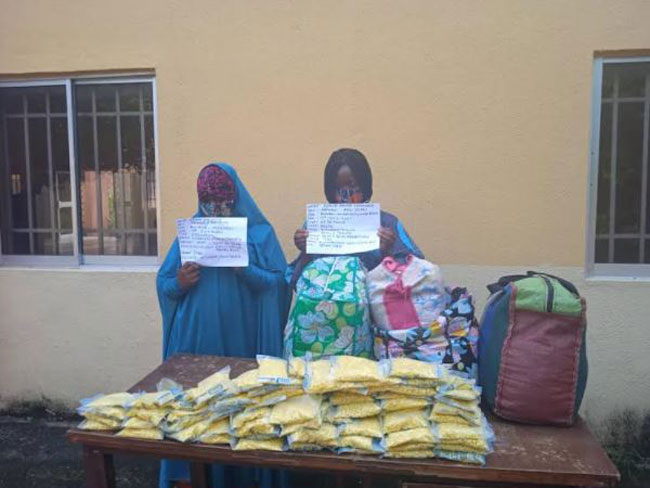 Chioma and Chidinma in hijab with exhibits