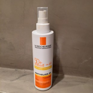 Plastic spray bottle with SPF 50 Anthelios sun screen milk by La Roche Posay. Anthelios XL.