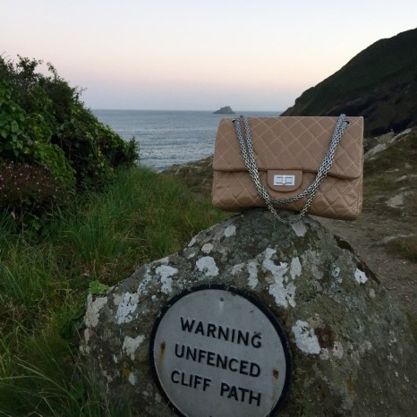 Coastal cliff path The LUgger Hotel Chanel bag