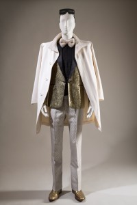 Tom Ford, overcoat, circa 1995, USA / Dsquared2, tuxedo jacket, Fall 2007, Italy / Gucci, trousers, circa 1995, Italy / Paul Smith, boots, England / Marc Jacobs, sunglasses, 2000s, USA. Lent by Robert Verdi. Photo courtesy The Museum at FIT.