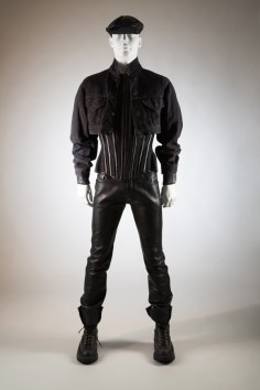Man's black leather ensemble: Levi's jacket, Mr. Pearl corset, Abel Villarreal pant and custom Wesco boots, worn by Scott Ewalt, 1990s. Photo courtesy The Museum at FIT.