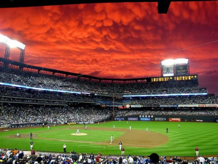 Bloody sky during a baseball game.