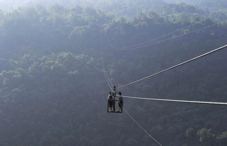 China Village is connected with Outside World by Dangerous Ropeway