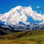 Mount McKinley or Denali in Alaska is the highest mountain peak in North America