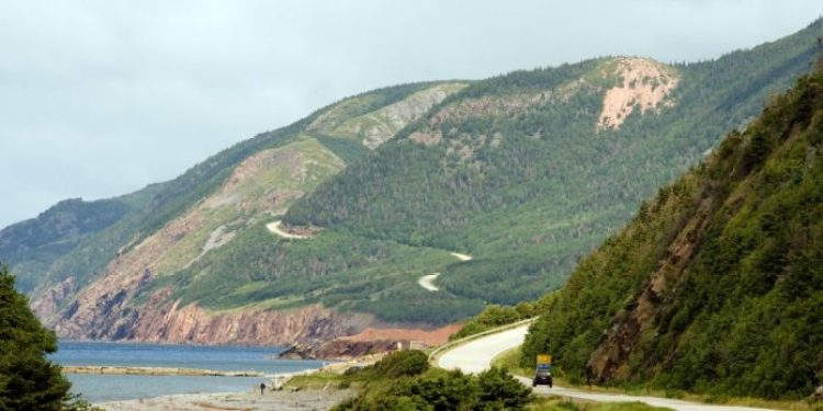 Cabot Trail in Nova Scotia is one of the most scenic drives in Canada, winding around the greater part of Cape Breton Island and offering views of both the woods and the ocean.