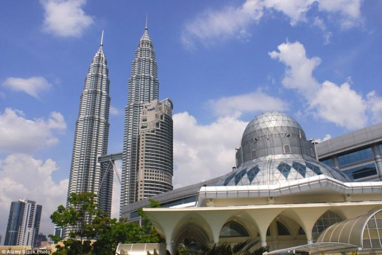 The Assyakirin Mosque in the centre of Kuala Lumpur, with the city's iconic Petronas towers soaring in the background