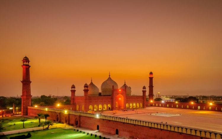 The Badshahi Mosque was built in 1673 by the Mughal Emperor Aurangzeb in Lahore, Pakistan. The large orange-coloured building is capable of accommodating over 55,000 worshippers