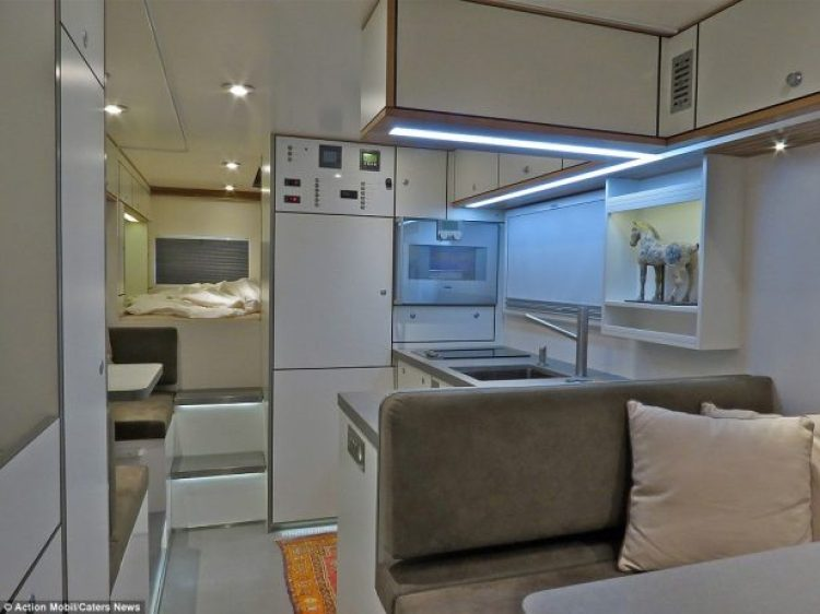 The vehicle, described as a 'motorhome for globe cruise' features comfortable chairs, a fully kitted-out kitchen and bedroom area