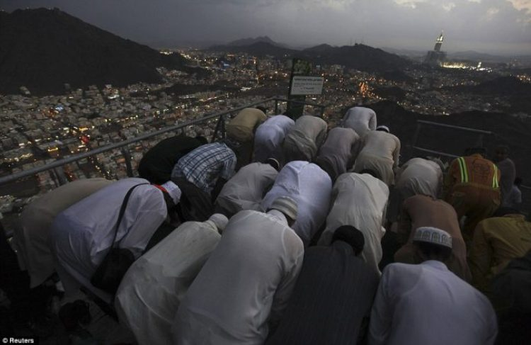 Muslim pilgrims pray at the top of Mount Noor.
