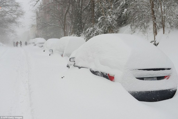 Cars were nearly buried under huge snow drifts in Washington D.C. on Saturday as record breaking snowfall came to the eastern U.S.