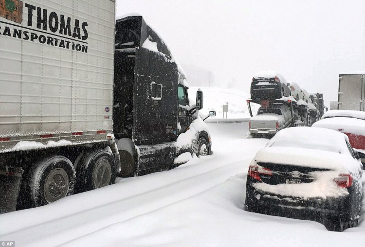 National Guard have been on hand to distribute water, food and fuel to the stranded drivers as the snow continued to fall