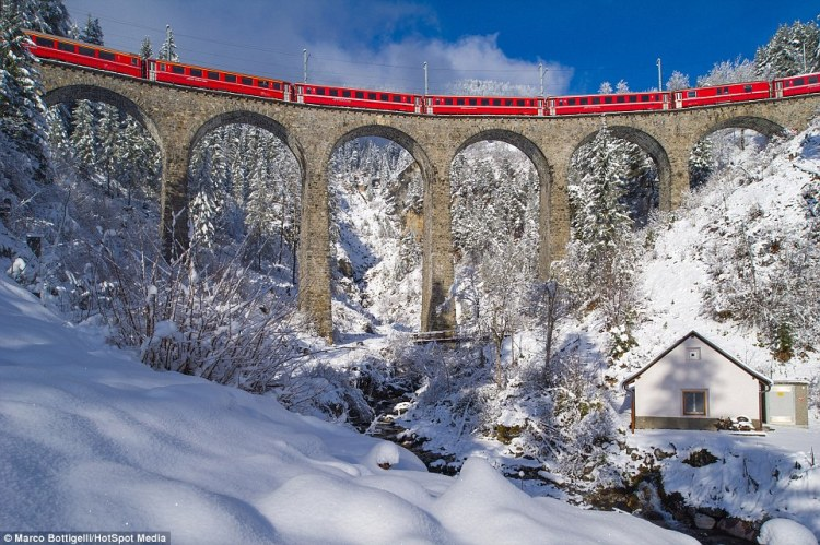 Marco Bottigelli, 34, and Francesco Vaninetti, 36, travelled on the Bernina Express and photographed the views from the train. Pictured is the Schmittentobel Viaduct in Schmitten
