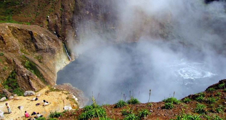 The Boiling Lake is flooded fumarole 10.5 km east of Roseau Dominica, filled with bubbling greyish blue water, normally enveloped in a cloud of vapour.