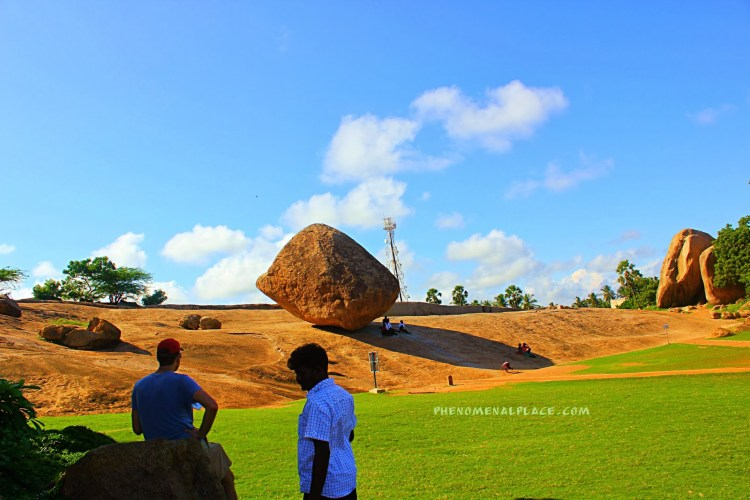 The robust 20 feet rock clearly defy gravity, seems will roll at any moment, and all efforts gets in vain so far.