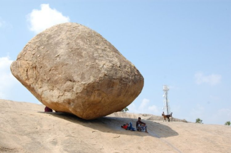 Moreover, so many tourists used the base as sun shield. So far, it has proved to be totally impossible to move the boulder.