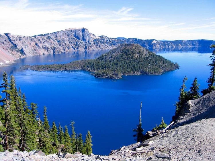 The Crater Lake is five to six miles across with a caldera rim ranging in elevation about 7,000 to 8,000 feet with average depth is 1,148 feet, while maximum measured depth is 1,949 feet.