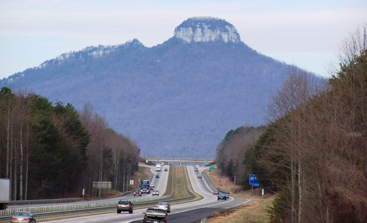 Pilot Mountain State Park is a popular destination for canoeing, fishing, horseback riding, picnicking, and rock climbing