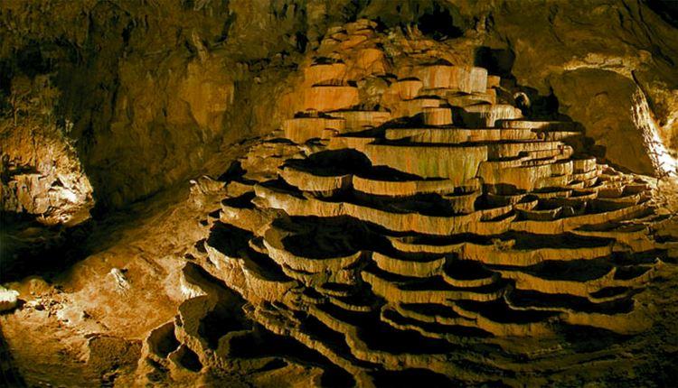 Terraces of precipitated calcium carbonate inside Skocjan Caves.