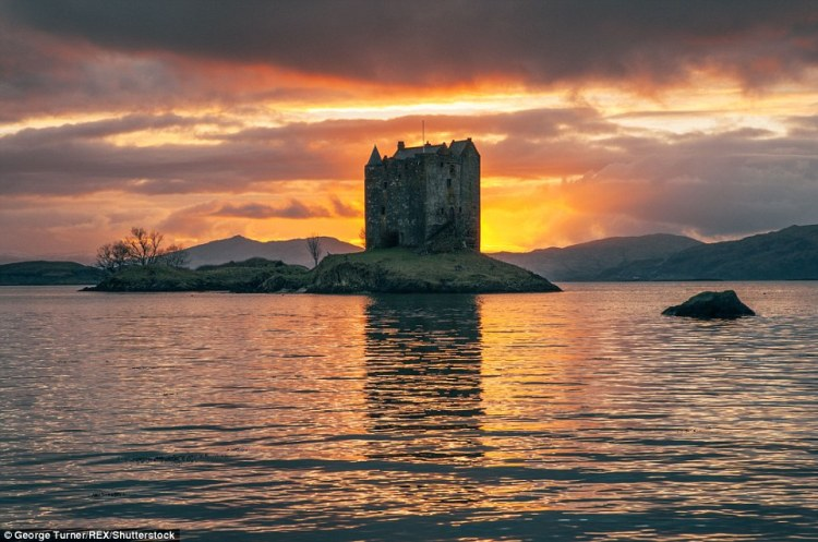 A picture of Castle Stalker in Appin, Argyll, with the sun setting over Loch Laich