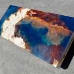 Combination of Natural Stone and Resin Coffee Table Brings the Relaxing Beauty of the Ocean Indoors