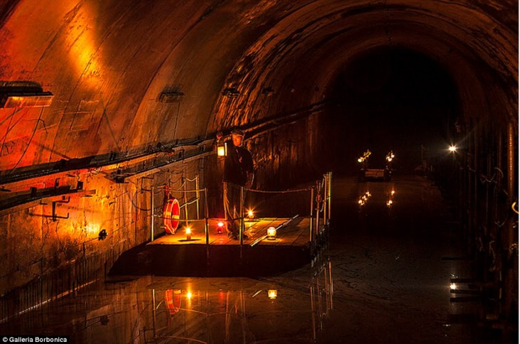 Tourists can take a raft ride through one of the flooded tunnels, with guides lighting the way with lanterns