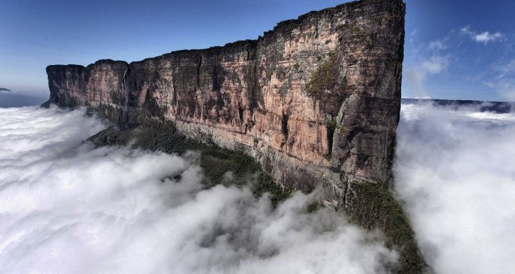 "A mystic, flat-topped mountain on the Venezuela-Brazil border that mystified 19th-century explorers and inspired ""The Lost World"" novel is enticing ever more modern-day adventurers."
