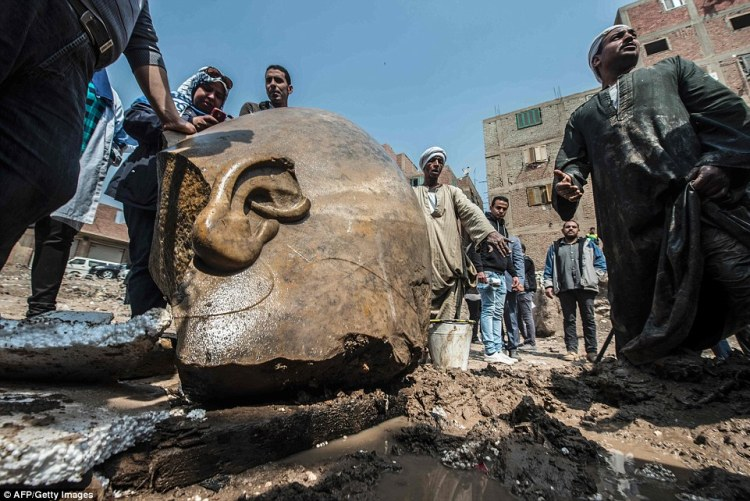 It is believed to be a mammoth statue of Ramses the Great. It was pulled from the mud and groundwater by a bulldozer