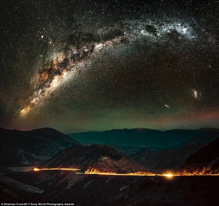 The scattered stars of the Milky Way light up the sky above the main highway through the southern Alps in the South Island of New Zealand