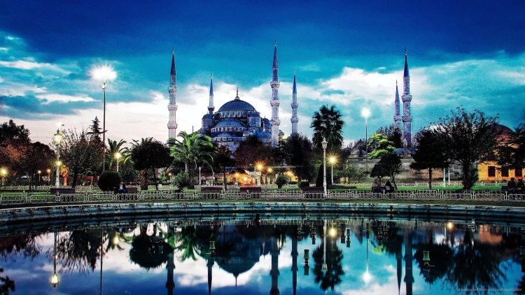 Its Külliye contains Ahmed's tomb, a madrasah and a hospice. Hand-painted blue tiles adorn the mosque's interior walls, and at night the mosque is radiant in blue lights frame the mosque's five main domes, six minarets and eight secondary domes.