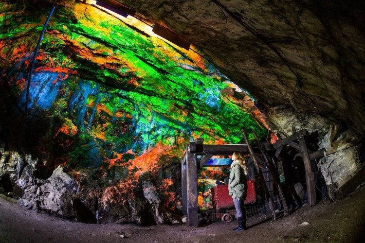 The fluorescent exhibits are displayed along the walls of Rainbow tunnel that was excavated in 1990, are lined with rare minerals that glow bright green and red under ultraviolet light.