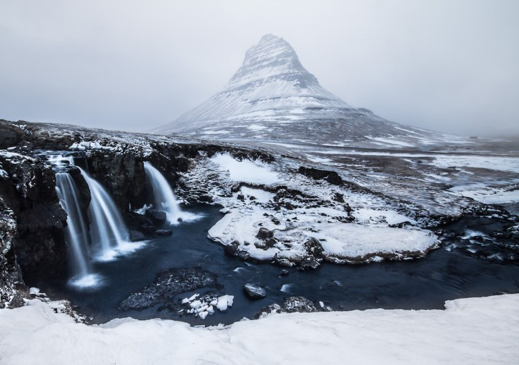 Kirkjufell, or Church Mountain, played peek-a-boo behind rolling clouds of fog, and as snow started falling around mountain. Photo Credit Elisabeth Brentano