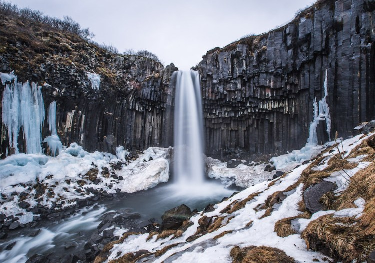 Svartifoss, or Black Fall, which has the unique distinction of being surrounded by hexagonal basalt columns.