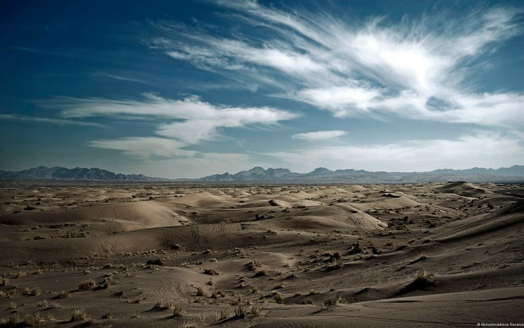 The Dasht-e Kavir, is one of two deserts dominating the region's landscape, is a mix of sand and salt as blinding in its whiteness as it is deafening in its silence.