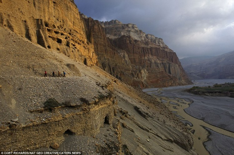 Climbers and scientists follow a trail above the Kali Gandaki River