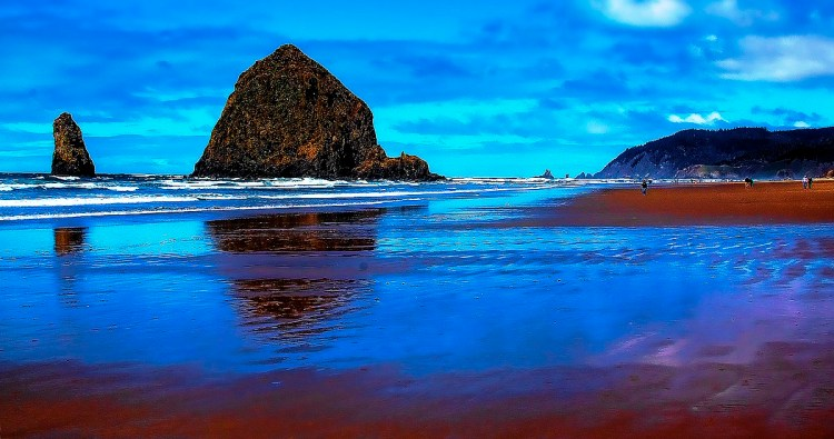Haystack rock is a popular tourist destination is nearby to the beach and accessible by foot at low tide.
