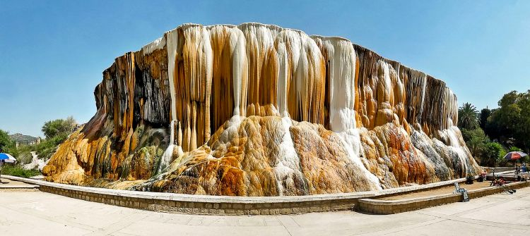 The dramatic, multicolored travertine walls of the spring have attracted thousands of visitors since the era of the Roman Empire  and side e view of the hot springs