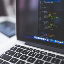 laptop and Wordpress code texts