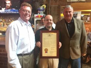 Rep. Redmon, CEO Terry Combs, & Rep. Walker with house resolution in honor of CVA's 35 Anniversary