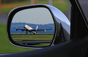 Airport transportation to Castro Valley Airport, seen through drivers mirror.