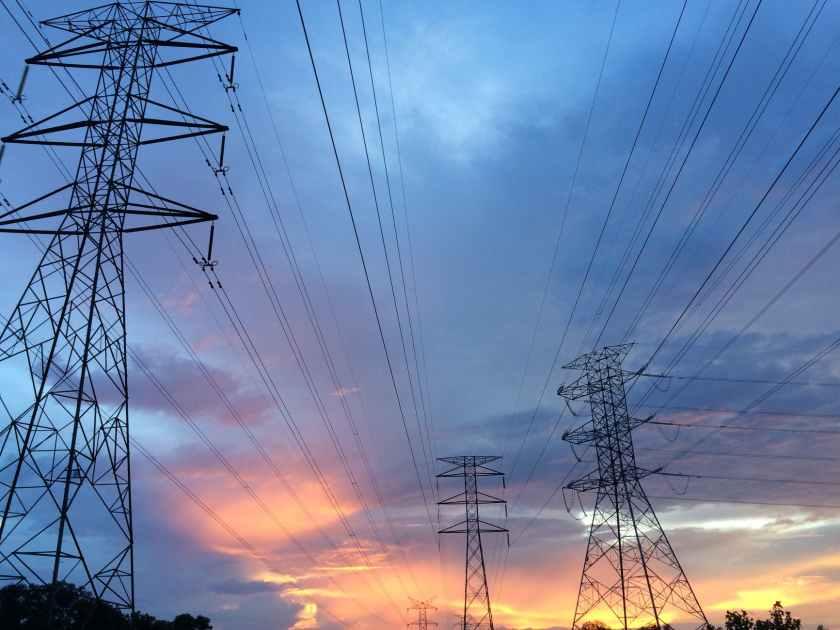 transmission tower under gray sky