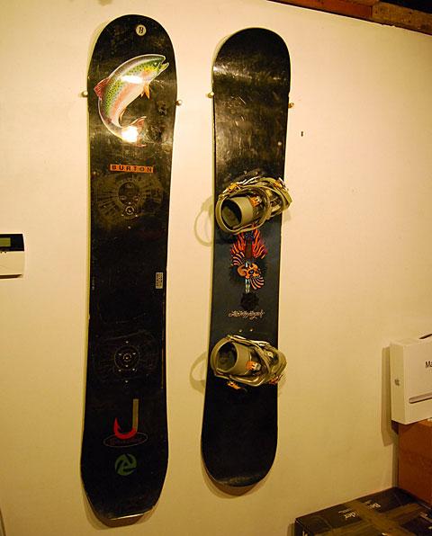 snowboard storage doubles as decor. Black Bedroom Furniture Sets. Home Design Ideas