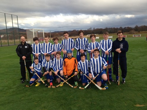 Mr Tillman (L) and Mr Todd (R) with the Wade Cup Shinty Team