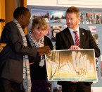 Mr O'Neill receives a student painting from Mr Dineo