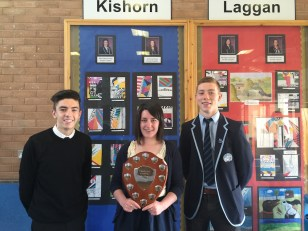 New House Captains Ben Watson & Alex Murray present the House Shield to Beth MacDonald, one of the Kishorn House Captains last session.