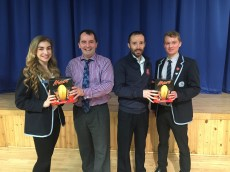 Melissa Fife and Andrew Johnstone receive their Easter eggs from Mr Stewart and David Donaldson